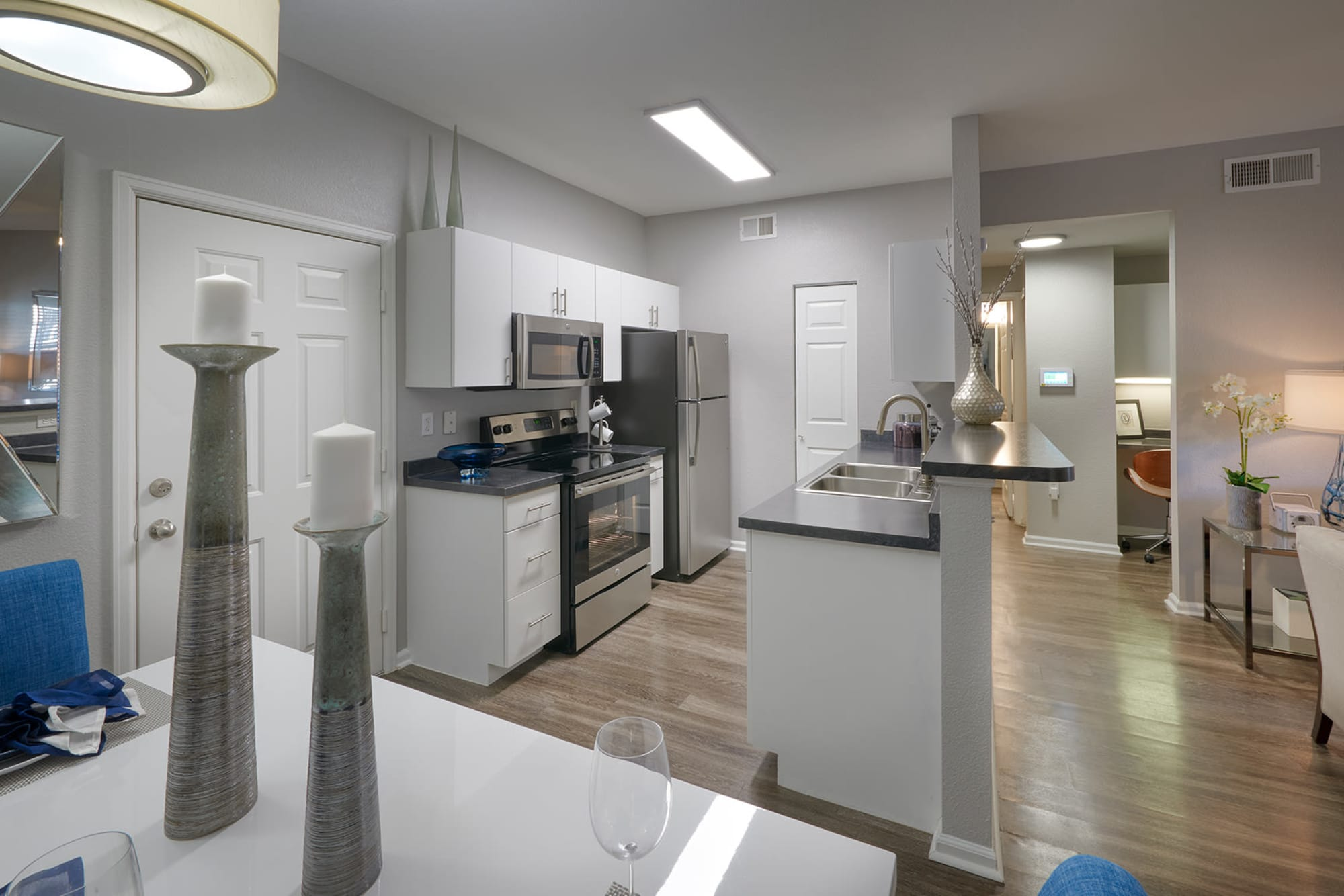 Renovated kitchen with white cabinets at Crestone Apartments in Aurora, Colorado