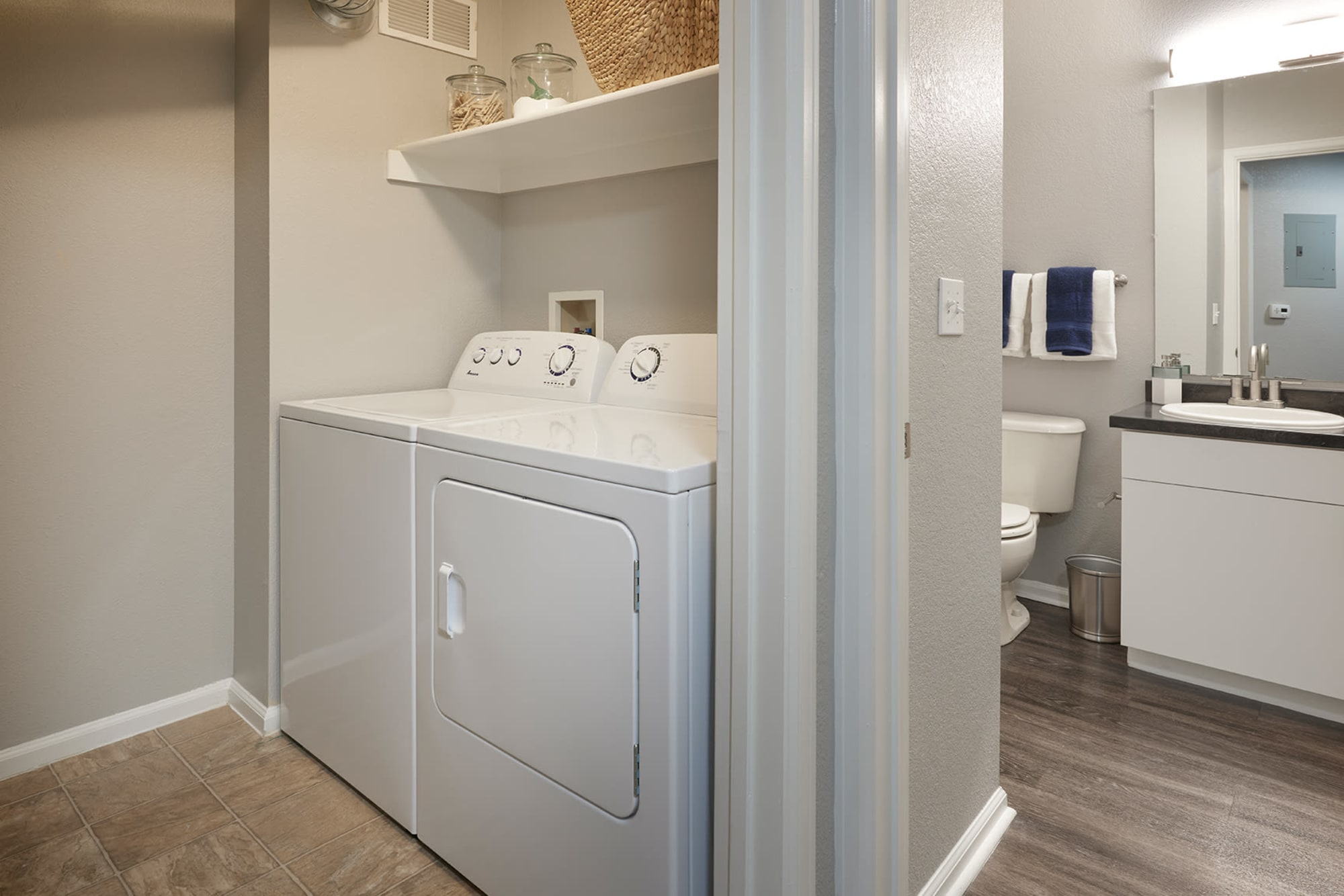 A washer and dryer combo at Crestone Apartments in Aurora, Colorado