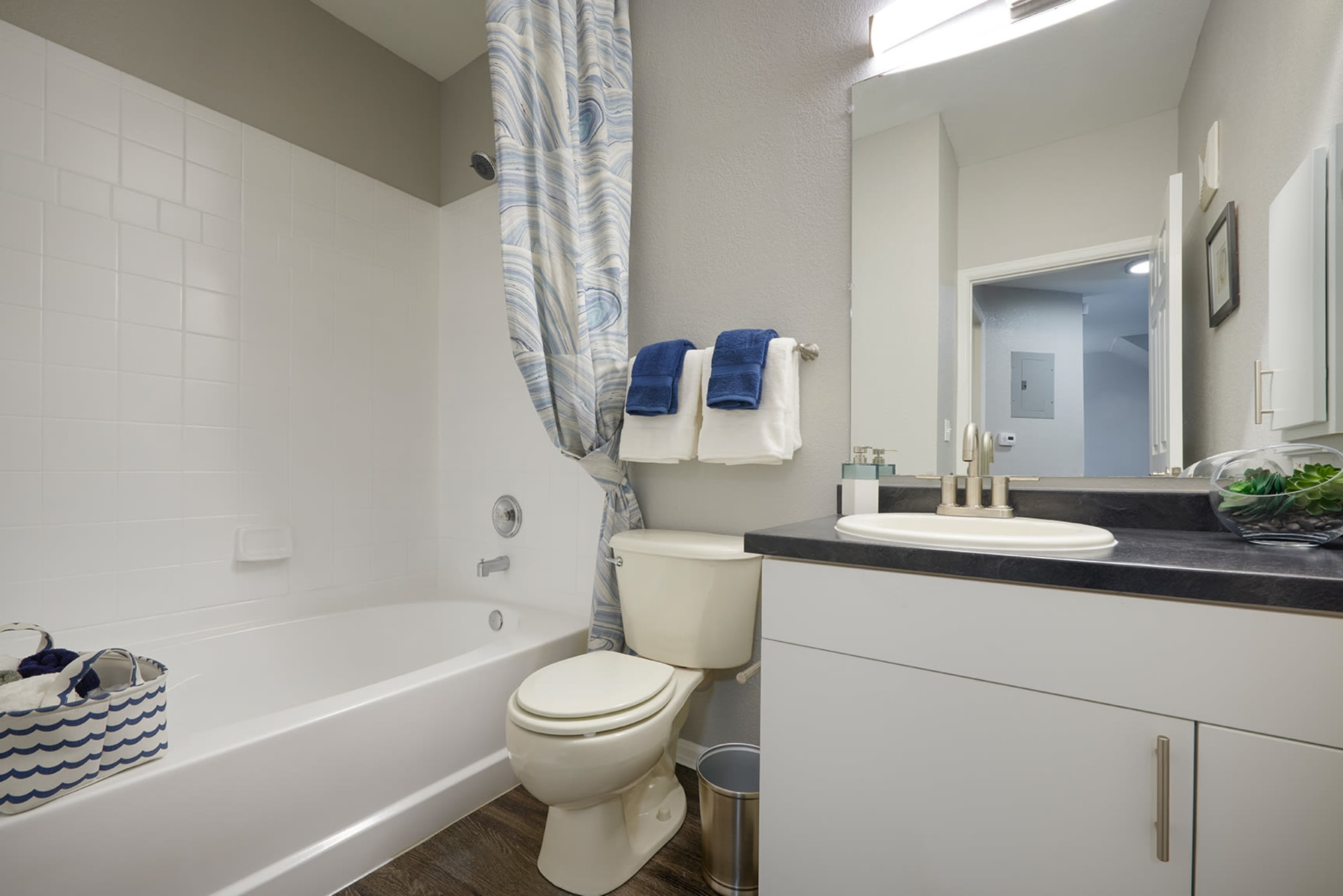 A bathroom with a shower, sink and lots of counter space at Crestone Apartments in Aurora, Colorado