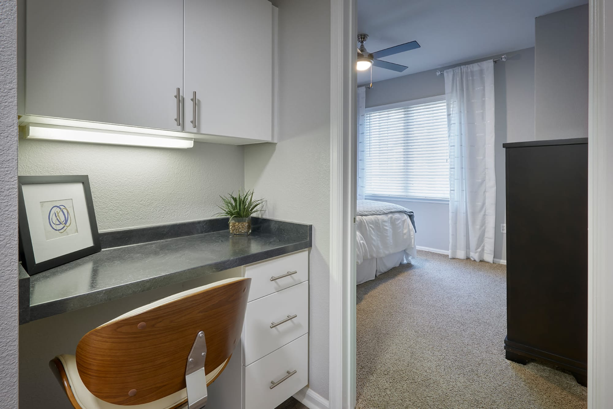 An office space next to the bedroom at Crestone Apartments in Aurora, Colorado