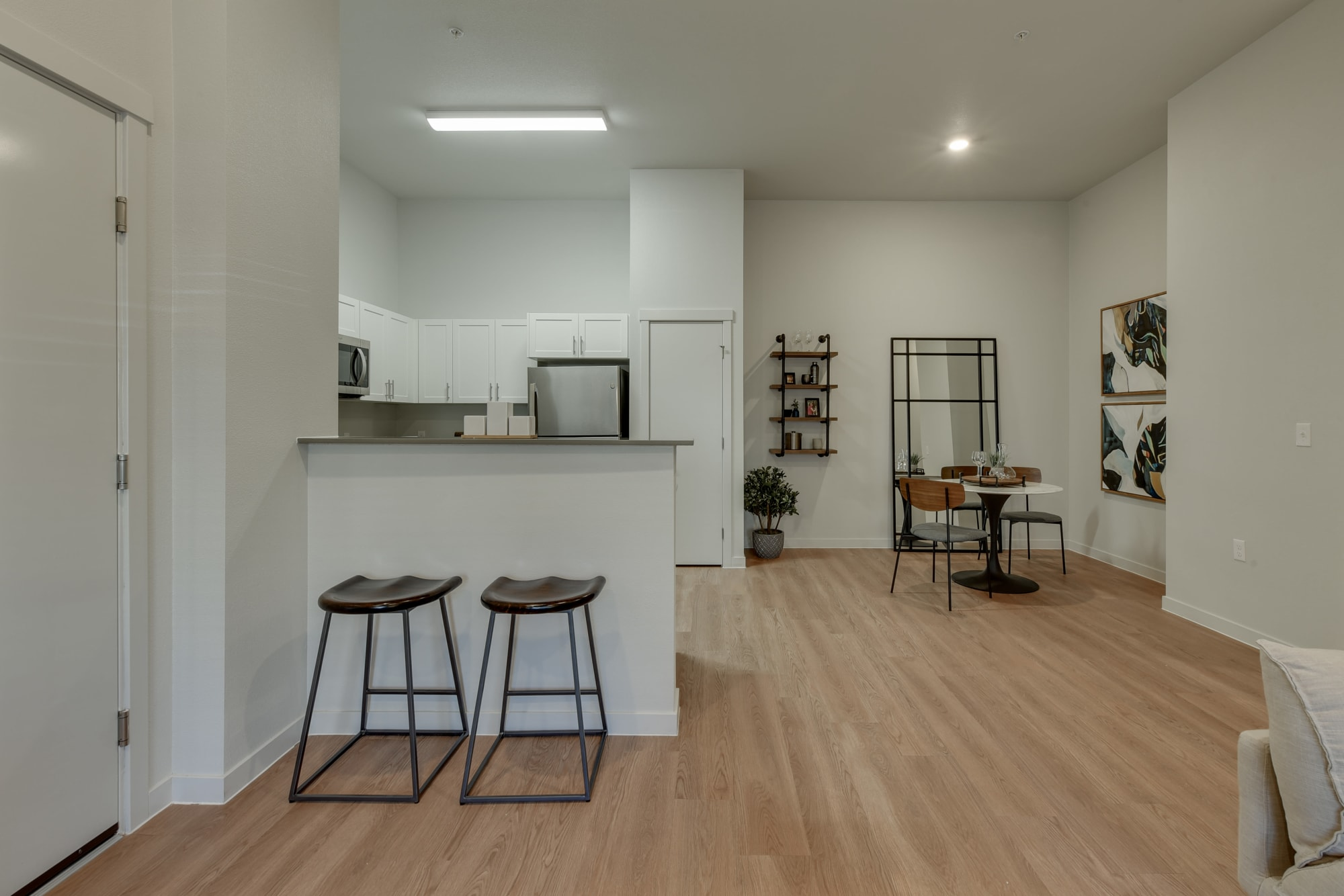 Kitchen with breakfast bar and dining room at Kestrel Park in Vancouver, Washington