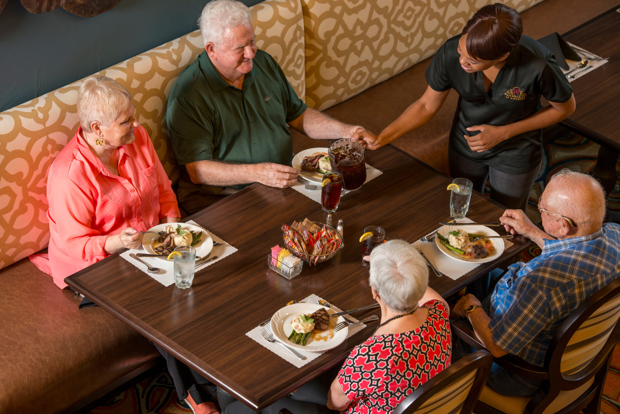 Residents enjoying a meal at an Integrated Senior Lifestyles community