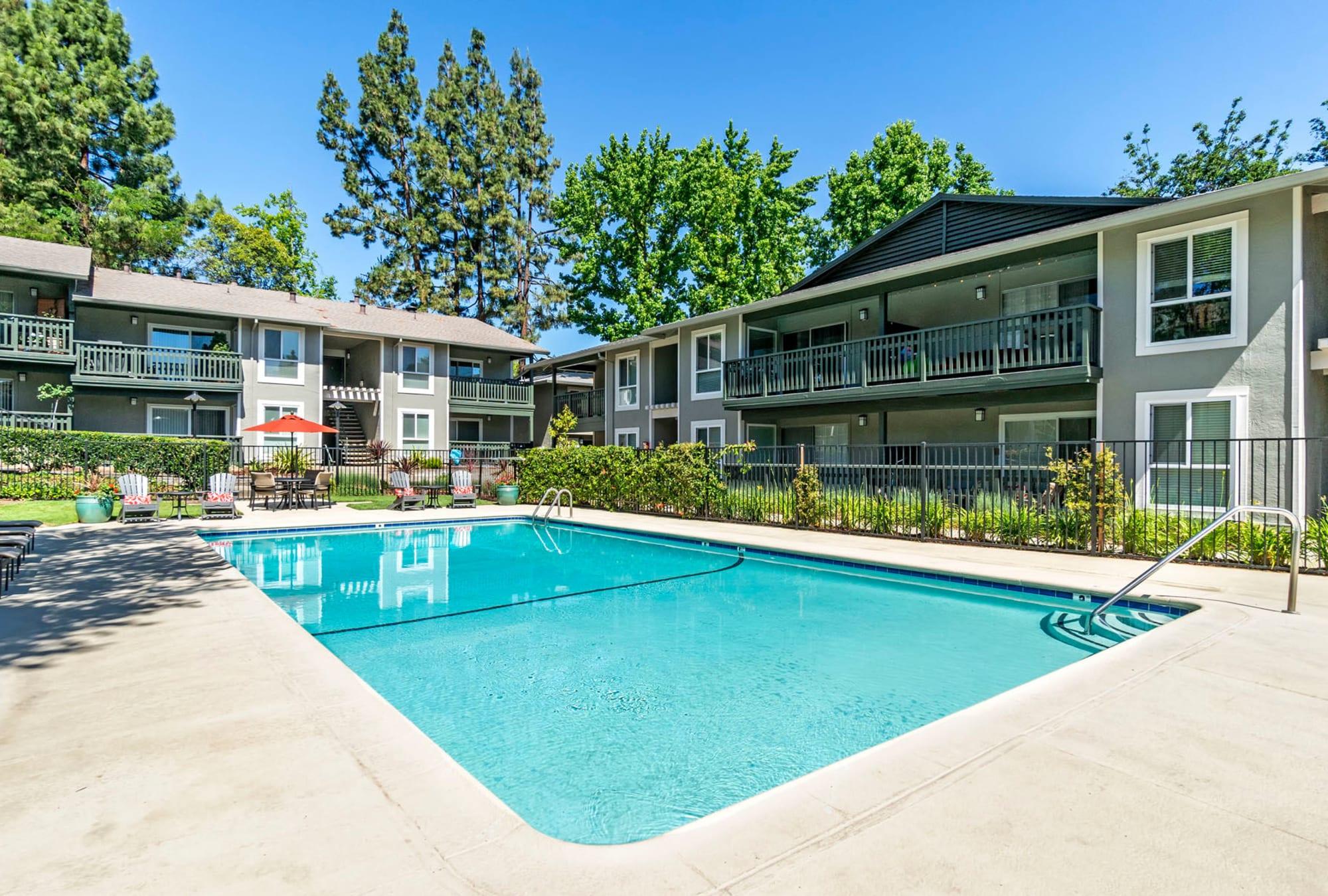 Gorgeous day at the swimming pool at Pleasanton Glen Apartment Homes in Pleasanton, California
