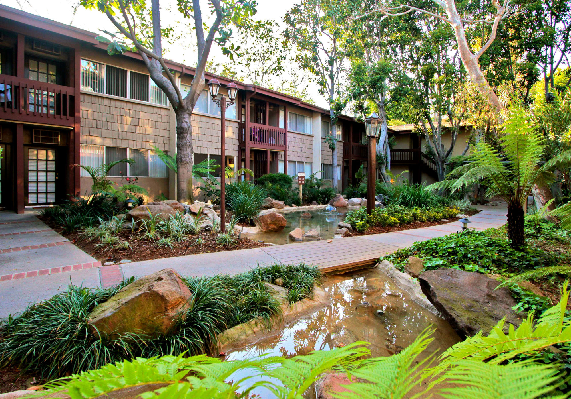 Lush landscaping and water features throughout the community at Rancho Los Feliz in Los Angeles, California