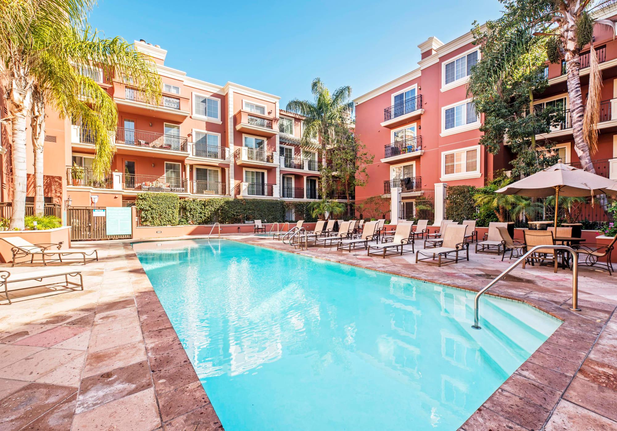 Resort-style swimming pool on a beautiful day at The Villa at Marina Harbor in Marina del Rey, California