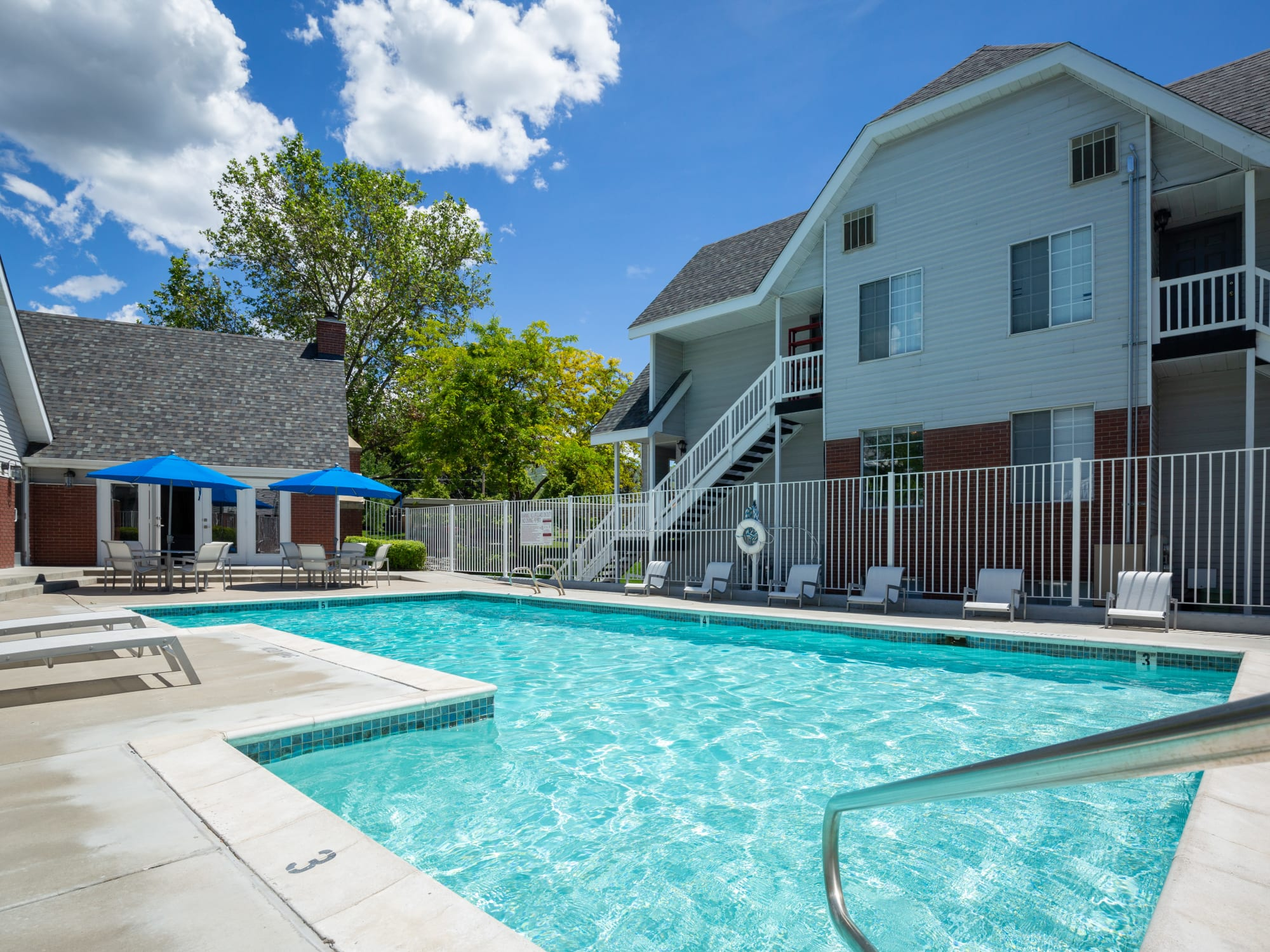 Sparkling Pool View with lounge chairs and umbrellas in Bountiful, Utah