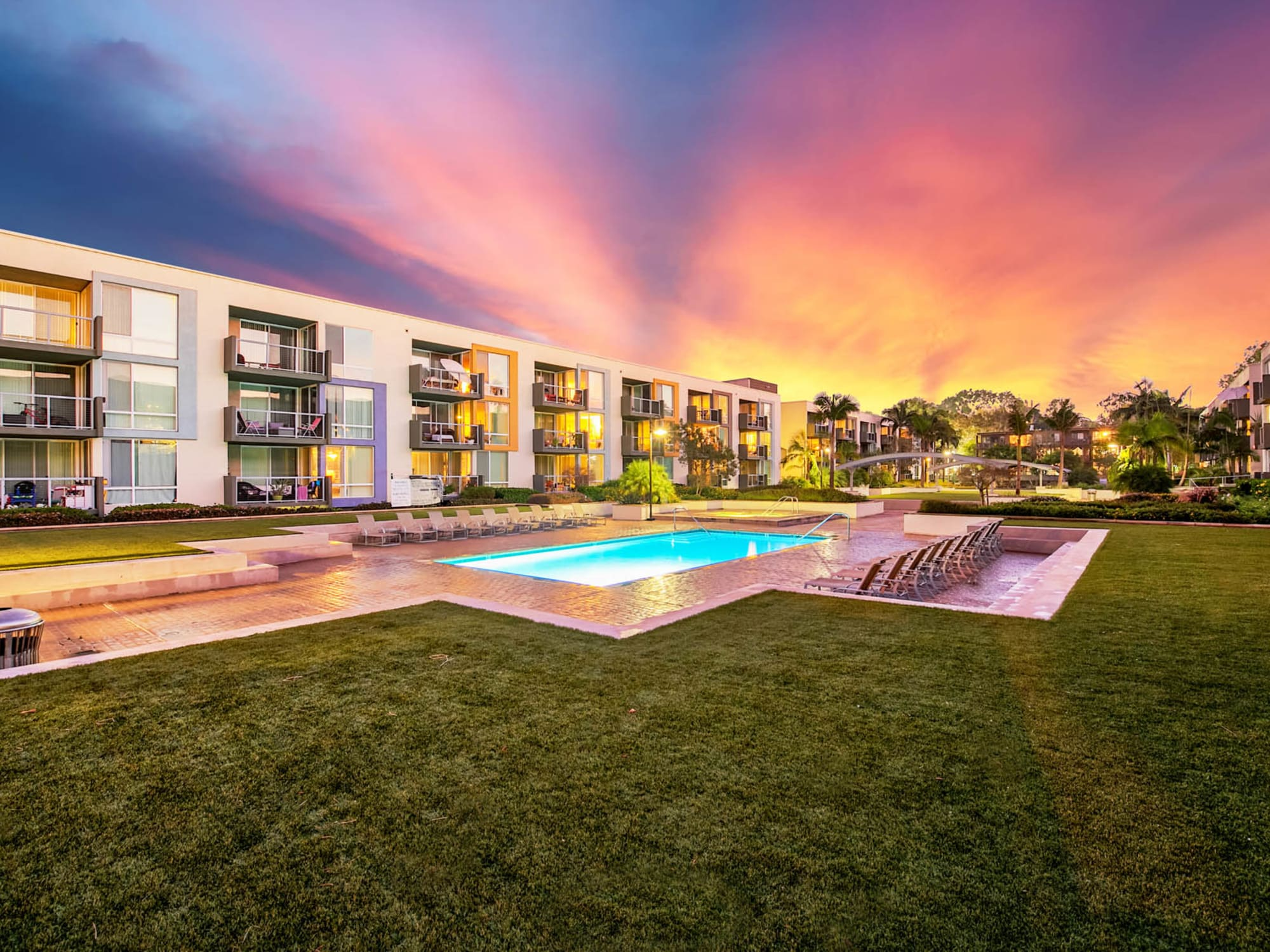 Gorgeous sunset over the swimming pool area at Waters Edge at Marina Harbor in Marina Del Rey, California
