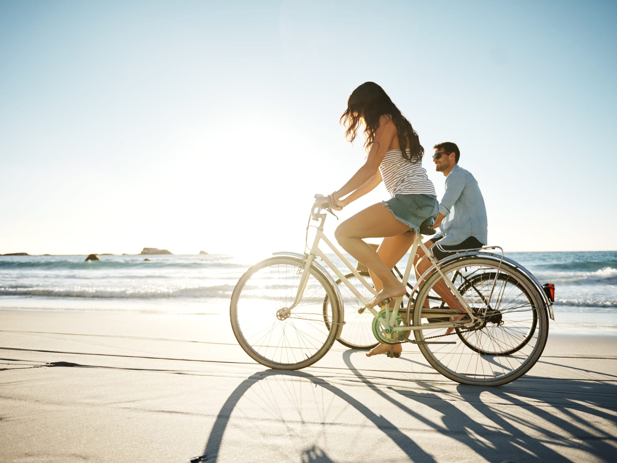 Residents riding bicycles on the beach near The Tides at Marina Harbor in Marina Del Rey, California