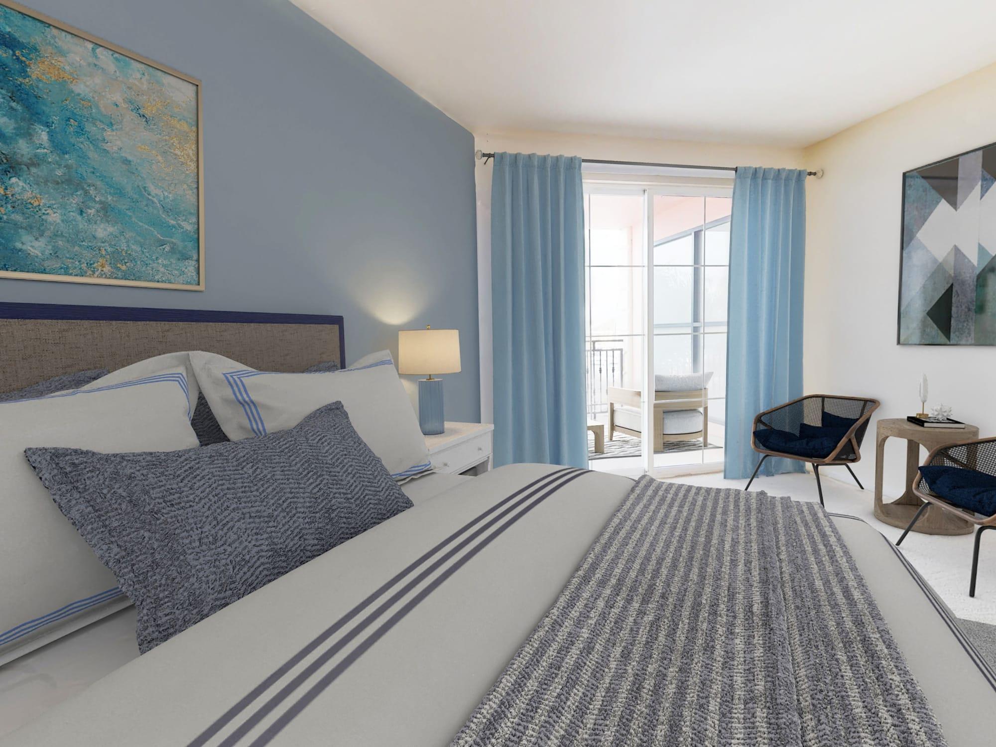 Extra large bedroom with sitting area and balcony overlooking waterfront marina at The Villa at Marina Harbor in Marina del Rey, California