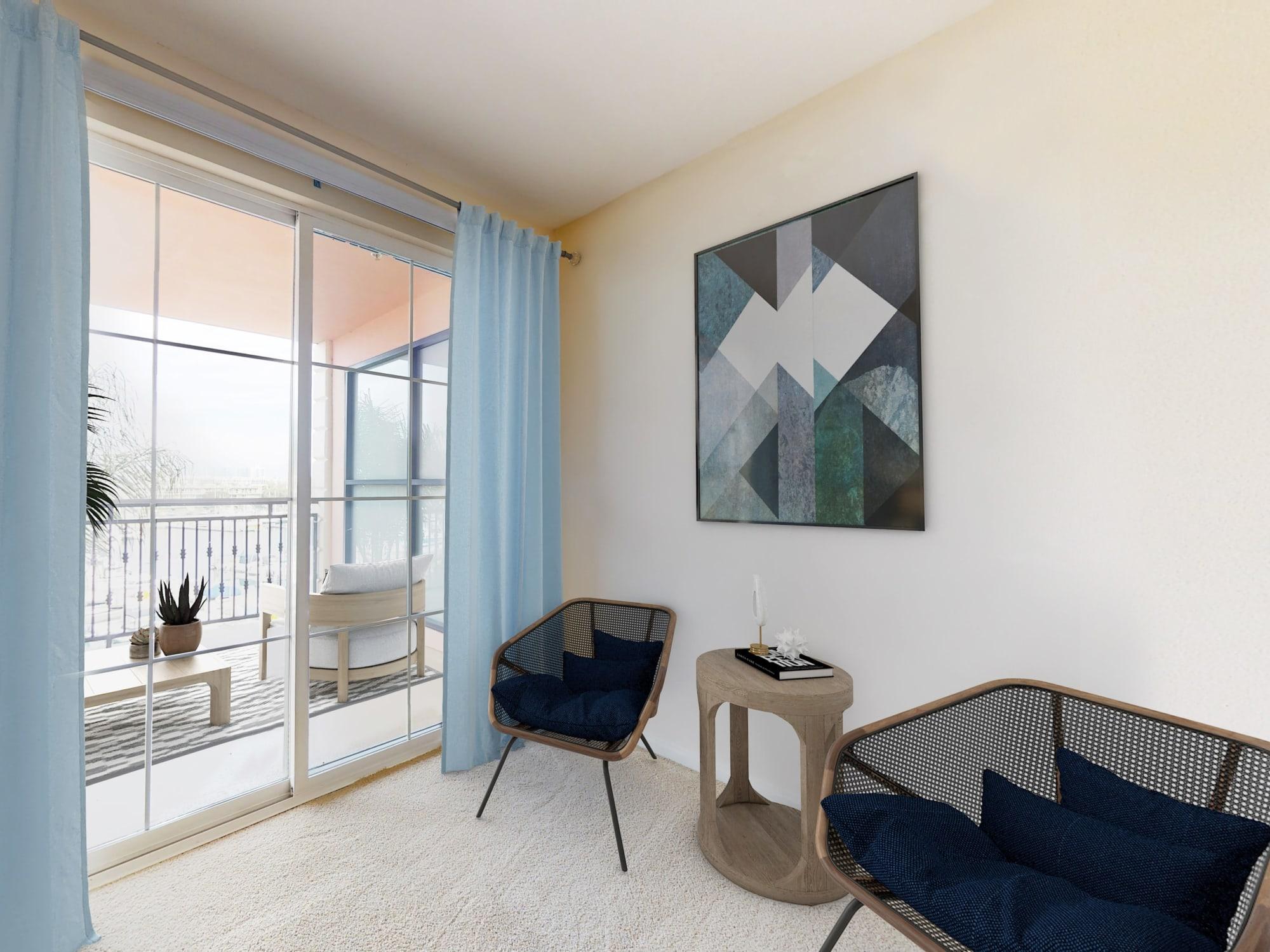 Lounge area inside spacious bedroom with balcony overlooking the marina at The Villa at Marina Harbor in Marina del Rey, California