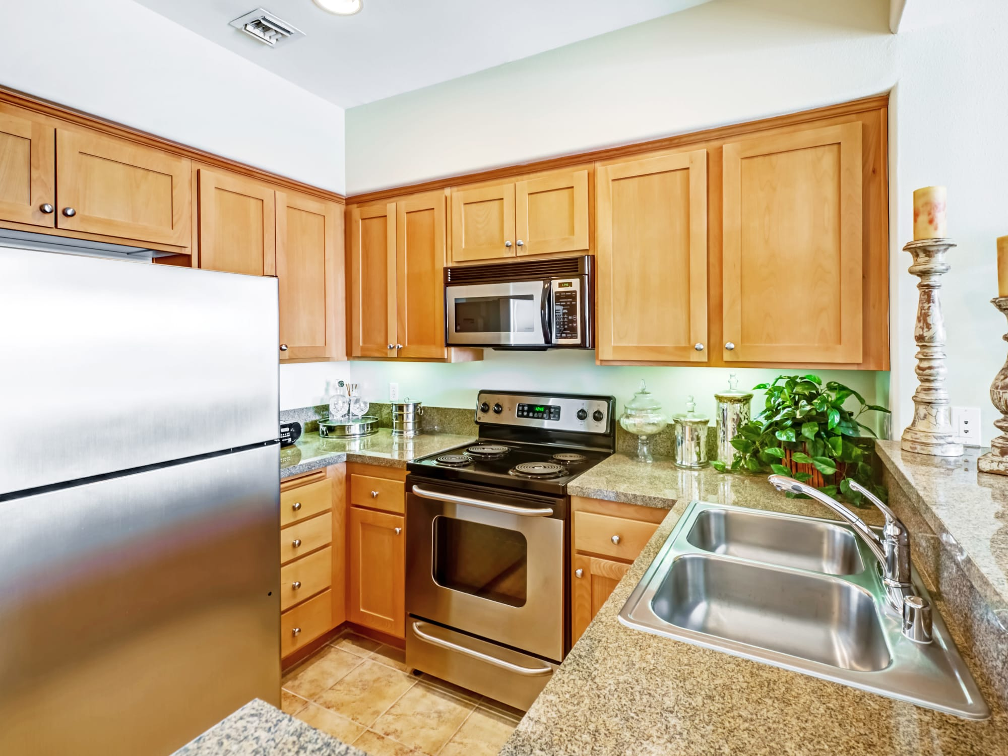 Modern kitchen with stainless-steel appliances in a model home at The Villa at Marina Harbor in Marina del Rey, California