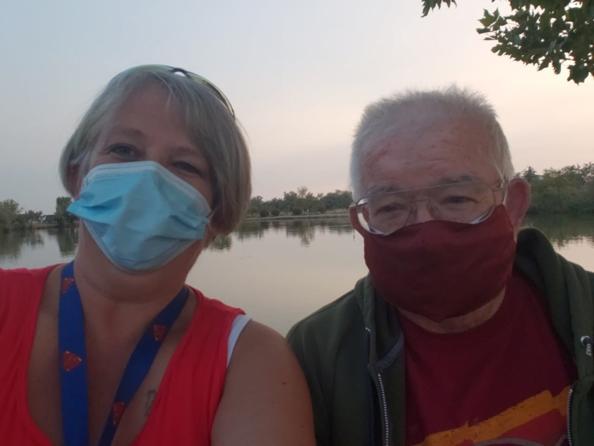 A couple in masks at Chancellor Gardens in Clearfield, UT