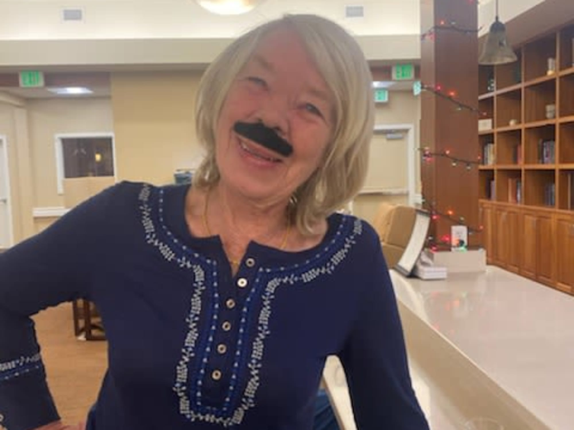 Wearing a fake moustache at Seven Lakes Memory Care in Loveland, Colorado