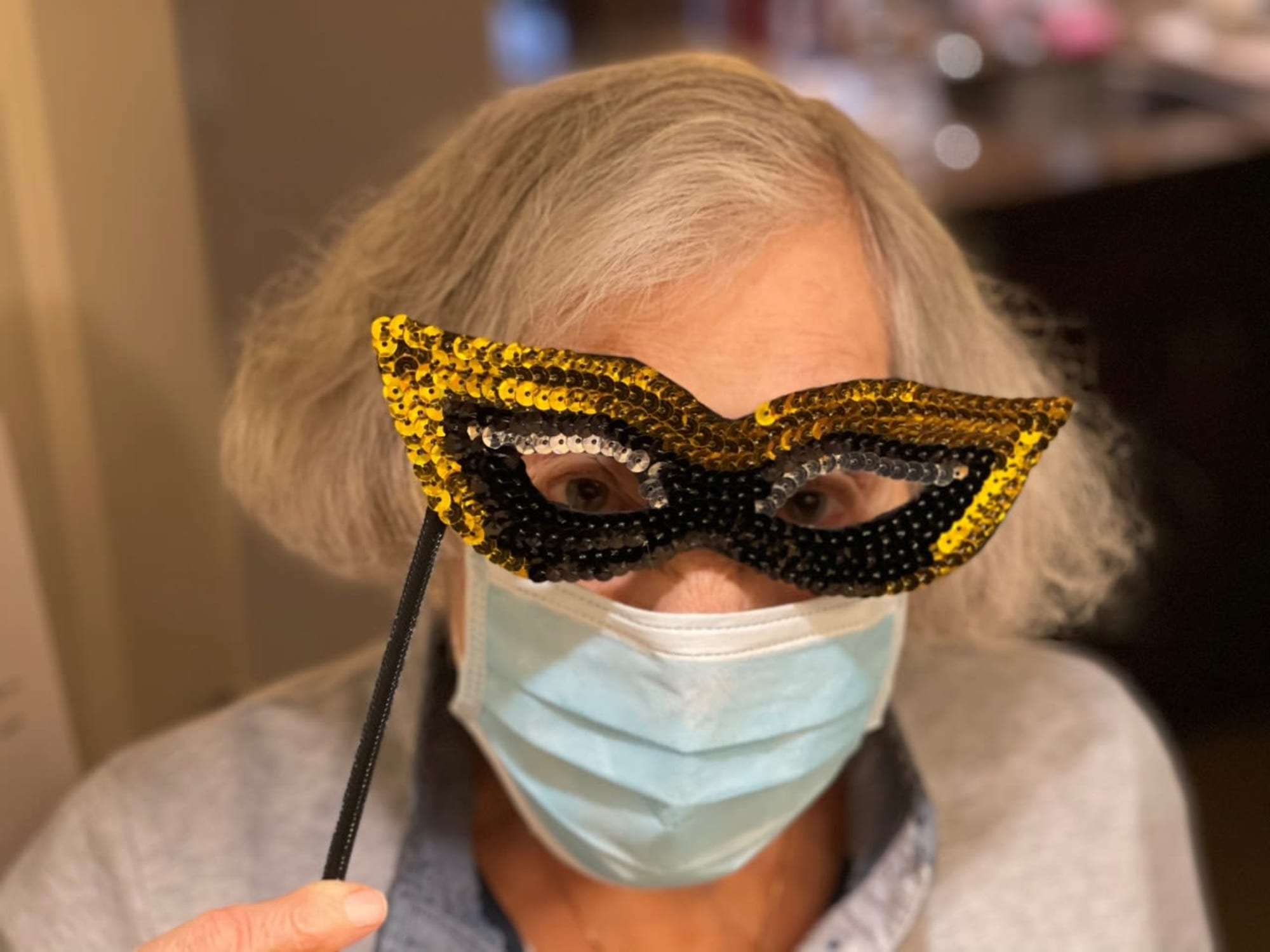 Holding up a mask at The Bellettini in Bellevue, Washington