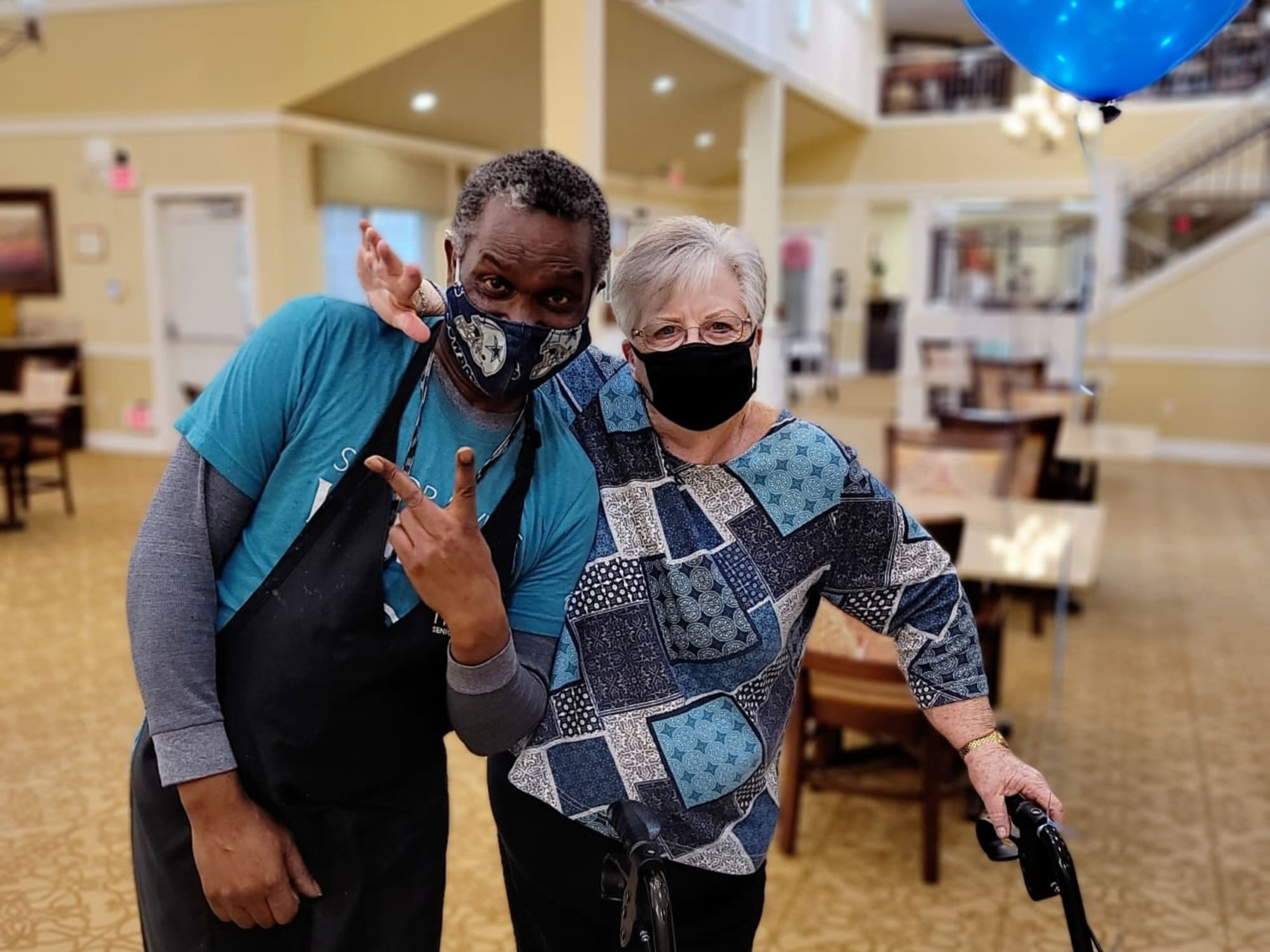 A staff member with a resident at The Commons at Elk Grove in Elk Grove, California