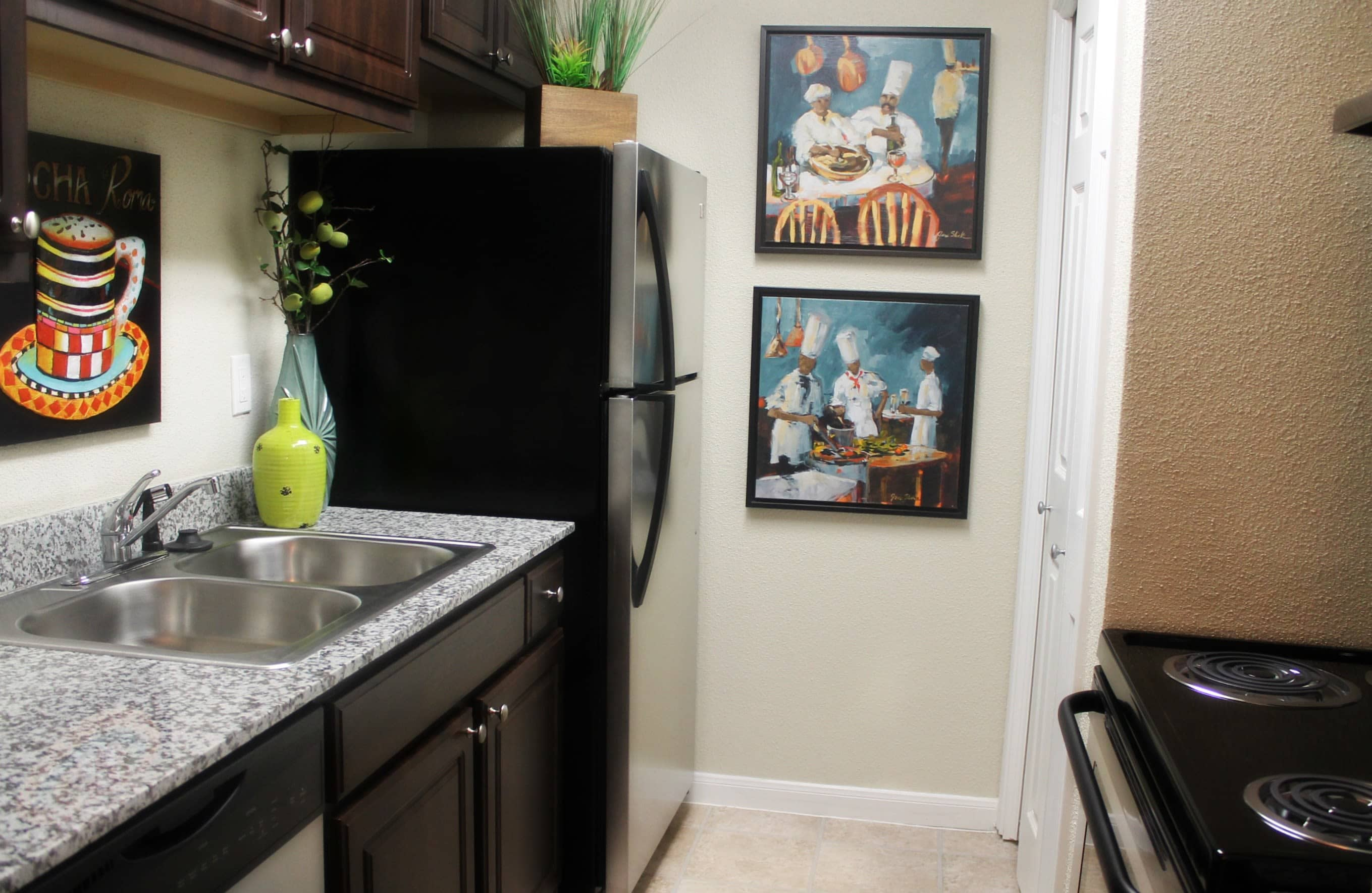 Fully equipped kitchen at The Abbey at Montgomery Park in Conroe