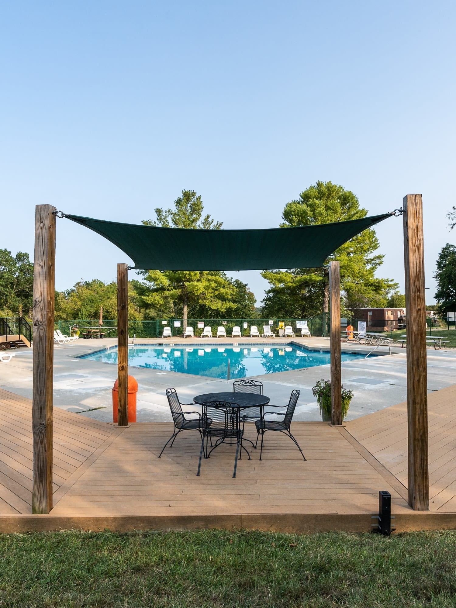 Covered seating for poolside lunches at Miamiview Apartments in Cleves, Ohio
