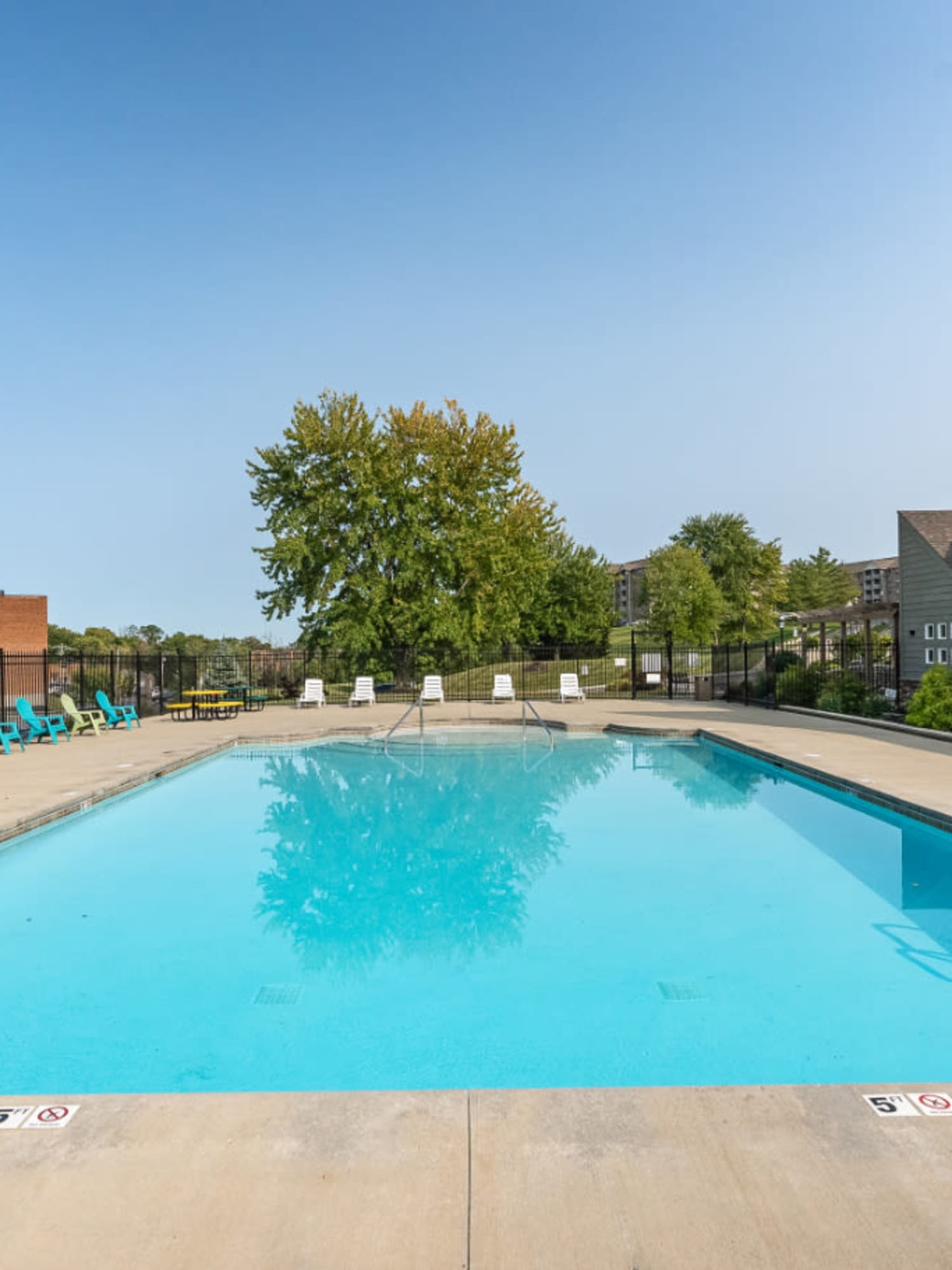 A large swimming pool with a sundeck at Vantage Pointe West Apartments in Cincinnati, Ohio