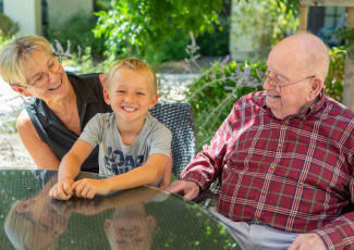 Residents with their grandson at Village Place Senior Living in Port Charlotte, Florida
