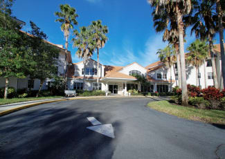 The front of the building at Sunset Lake Village Senior Living in Venice, FL