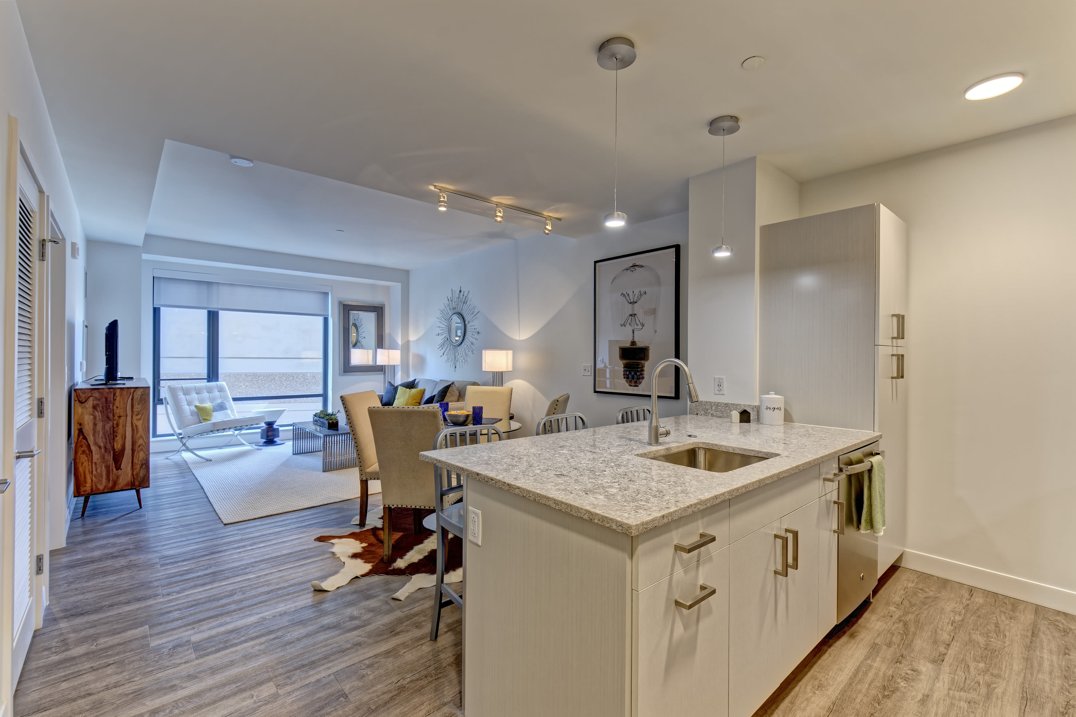 Kitchen with stainless-steel appliances and a breakfast counter at Vela on the Park in Stamford, CT