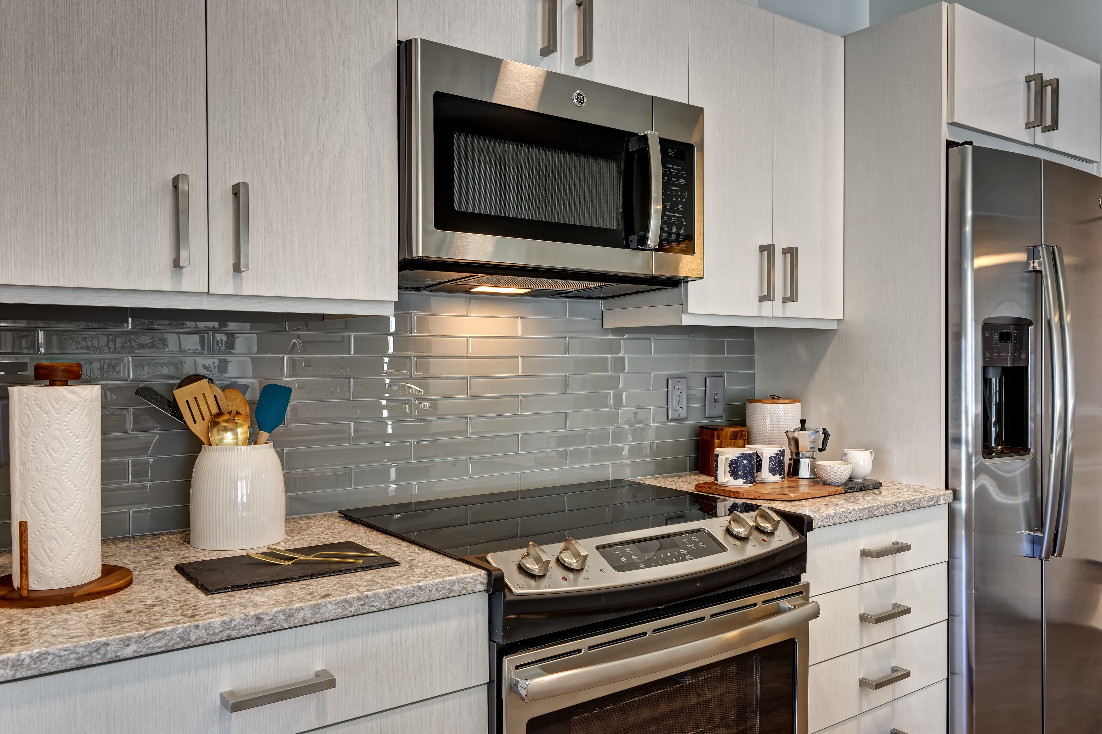Kitchen with stainless-steel appliances and spacious counters at Vela on the Park in Stamford, CT