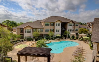 View of our apartments and swimming pool at Park Hudson Place in Bryan, Texas