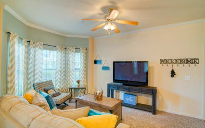 Living room with a ceiling fan at Park Hudson Place in Bryan, Texas