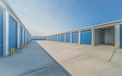 Driveway of storage units with roll up doors at Storage Star Salida in Salida, California