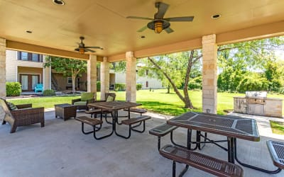 Outdoor tables at Park Hudson Place in Bryan, Texas