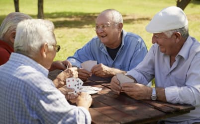 Playing cards at the senior living community in La Mesa