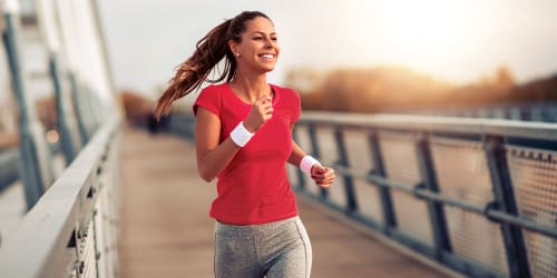 A women out for a jog near The Columbia at the Waterfront in Vancouver, Washington