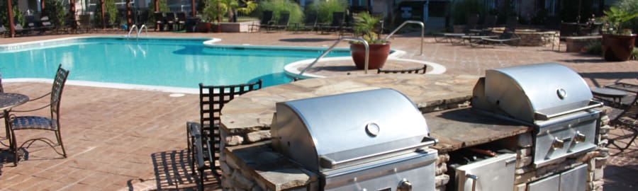 BBQ by the pool at Delaney Apartment Homes in Concord