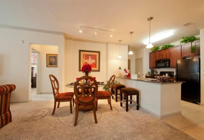 Dining area and kitchen in model home at Villas at Bunker Hill