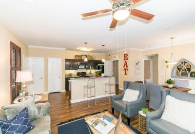Hardwood floors and ceiling fan in the living area at Hilltops in Conroe, Texas
