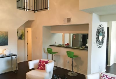 Living room and breakfast bar view at The Park at Ashford in Arlington, Texas