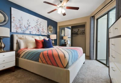 Enjoy a cozy bedroom at Ridgeview Place in Irving, Texas