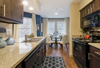 Kitchen and dining area view at Ridgeview Place in Irving, Texas