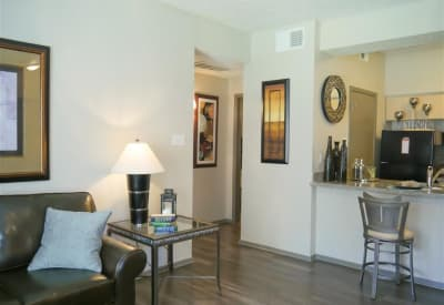 A modern living room provides ample space for entertaining at Veridian Place in Dallas, Texas