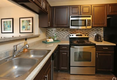 Enjoy a luxury kitchen at Village Green of Bear Creek in Euless, Texas