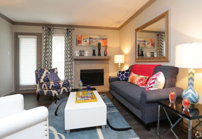 Village Green of Bear Creek showcases a well-decorated living room in Euless, Texas