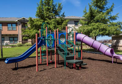 Children's playground with slides at Ranch ThreeOFive in Arlington, Texas