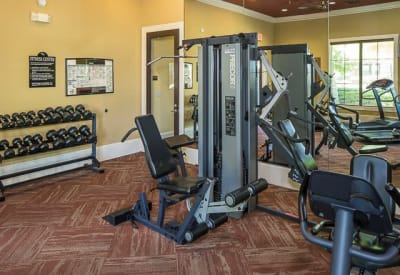 Resident fitness center with a full weight set at Ranch ThreeOFive in Arlington, Texas