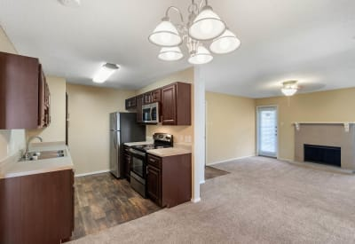 Spacious floor plan with plush carpeting at The Logan in Bedford, Texas