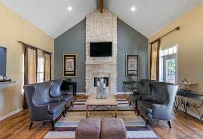 Spacious clubhouse with wood-style flooring at The Logan in Bedford, Texas