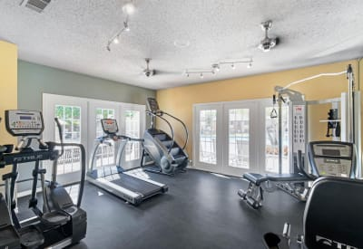 Spacious resident gym with treadmills at The Logan in Bedford, Texas