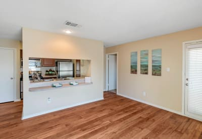Kitchen with a pass-through window at The Logan in Bedford, Texas