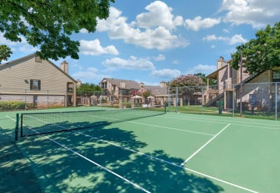 Large tennis outdoor tennis court at The Logan in Bedford, Texas