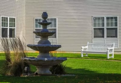 View of fountain and seating near exterior walking path at Mattison Crossing at Manalapan Avenue in Freehold, New Jersey