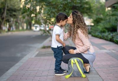 Resident mom walking her son to school near Regency Place in Wilmington, Massachusetts